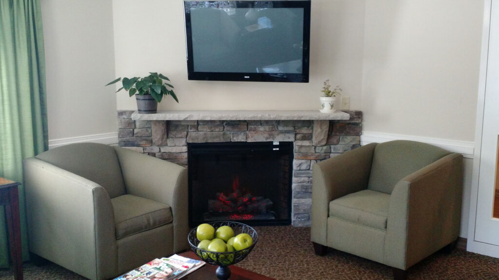 Residents at Alamance House can enjoy an afternoon by the fireplace
